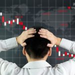 55617805 - an investor is looking at screen showing stock market crash